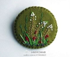Pretty embroidered brooch