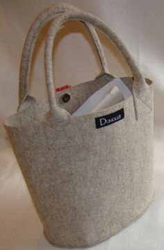 Understated elegance this pure wool felt bag by SpareRoomClutter