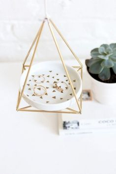 Upgrade your jewelry dish with a cool brass hanger.