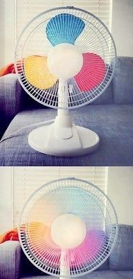 Paint primary colors on fan blades to make a rainbow fan