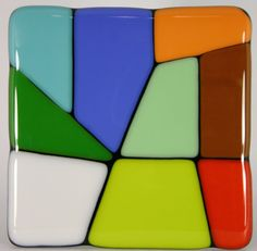 Mosaic coaster: Brilliant, color and shine. This coaster really catches the eye and brightens the day. All of my coasters are handmade by fusing multiple