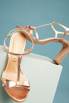 0a55c7d68ff0 Vicenza Metallic Bow T-Strap Heels