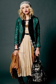 Love the dark lipstick, hair colour and green leather jacket