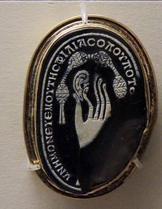Lover's keepsake - Cameo made from a pebble, Roman, 2-3c AD With Greek inscription : 'Wherever you are, remember me (and) the love (I bear you)'