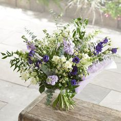This charming English meadow inspired bouquet is guaranteed to delight. Lilac stocks and purple lisianthus have been delicately intertwined with white spray roses to give this beautiful bouquet a freshly cut from the garden feel.