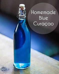 Homemade Blue Curaçao Made with a combination of vodka, gin, bitter orange peel and cloves, the from-scratch liqueur steeps for about 20 days before it& tinted and put to use in vibrant cocktails. Try it and make your own delicious blue curaçao! Liquor Drinks, Cocktail Drinks, Fun Drinks, Yummy Drinks, Alcoholic Drinks, Beverages, Bourbon Drinks, Cocktail Recipes, Homemade Liqueur Recipes