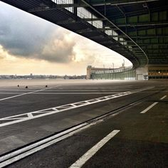 Berlin Tempelhof Airport ~ Ernst Sagebiel (1941) ~ One of the airport's most distinctive features is its massive, canopy-style roof extending over the apron and protecting passengers from the elements.