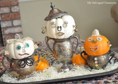 Bits and pieces of old jewelry, lace, buttons, watches, hardware, and tarnished silver pieces brought these little pumpkins to life.  I think it's their hands-on-hips pose that give them sass and attitude.