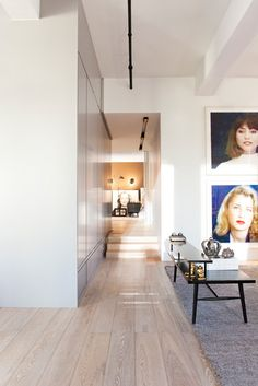 Tour an Airy New York City Loft That Mixes Old and New Designed by P&T Interiors Posted July 23, 2014 in Top Designers At Work by Dering Hall The visual and spatial experience is enhanced by the choreographed placement of artwork. The artists include Cindy Sherman, Julian Schnabel, Tom Sachs, Chris Burden, Nan Goldin, Marilyn Minter, Loretta Lux, Brigitte Lacombe and Cornford+Cross.
