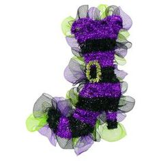 "Perfect for greeting guests, this festive accent features a tinsel witchs boot with purple and black stripes and coordinating tulle.  Product: Boot accentConstruction Material: Tulle and plasticColor: Black, purple and greenDimensions: 26"" H x 14"" W x 9"" DNote: Guaranteed delivery by HalloweenCleaning and Care: Wipe gently with a dry cloth. Avoid direct sunlight and humidity."