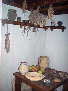 Reconstruction at Colchester Castle Museum including Roman tableware and foods such as fruit, nuts, spices and meat (duck). Picture taken June 2007.