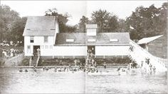"""The original bath house as it looked from the water. The caption to the 1904 booklet where this picture can be found reads, """"The bathing of course is very popular. Nowhere can it be indulged in with less danger of more delight. No treacherous holes, no sharp descents, no undertow. The beach descends gradually so that ladies and children can wade to any desired depth with perfect safety. During the warm months hundreds may be seen splashing in the water or sunning themselves on the beach…"""