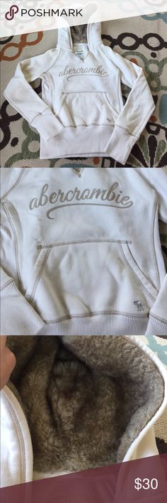 Abercrombie cream and fur super soft hoodie Excellent condition cream colored hoodie from Abercrombie kids. The stitching is light tan. The fur lines the inside of the hood and it is in perfect condition. It is suuuuper cozy and soft. Abercombie Kids Shirts & Tops Sweatshirts & Hoodies