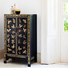 An elegant Chinese cabinet in black with a classic Oriental design in gold leaf The bold design, gold leaf edging and and antiqued metal work set off the sumptuous classic black finish A perfect statement piece delivering stylis Chinese Furniture, Oriental Furniture, New Furniture, Wooden Furniture, Black Sideboard, Small Sideboard, Chinese Cabinet, Black Bookcase, Oriental Design