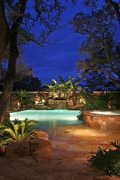 Gorgeous beach entry pool at night in San Antonio. This one  also has a waterfall and spa (hot tub).
