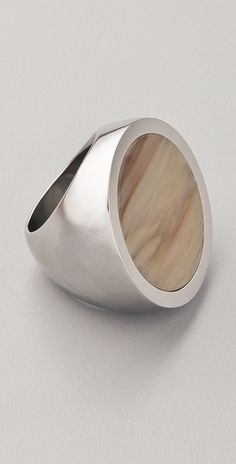 Like how simple this ring is. If you use the inherent beauty in the materials this well, you don't need anything else.    By Michael Kors