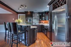 Kitchen with black cabinetry and stainless steel appliances Design Ideas & Pictures Espresso Cabinets, Dark Wood Cabinets, New Kitchen, Kitchen Dining, Kitchen Ideas, Discount Kitchen Cabinets, Ready To Assemble Cabinets, Kitchen Styling, My Dream Home