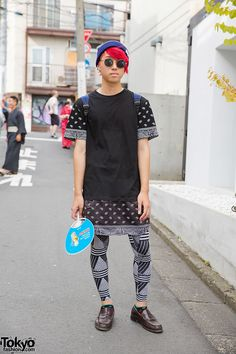 Meet Hyuga, a 17-year-old student with red hair. We spotted him in Harajuku and stopped him for a few snaps. He is wearing a WEGO culotte with H&M tights, a blue backpack, beanie and loafers. He accessorized with round sunglasses, a WEGO ear cuff and printed socks. (Tokyo Fashion, 2014)