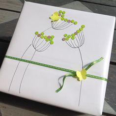 Simple Green Flowers Gift Wrap - Drew simple line flowers embellished them with hole punch dots, added simple ribbon and butterflie - wrap-it-up-with-a-little-whimsy ~ Beth O'Briant Present Wrapping, Creative Gift Wrapping, Creative Gifts, Diy Wrapping Paper, Wrapping Ideas, Wrapping Papers, Diy Paper, Craft Gifts, Diy Gifts