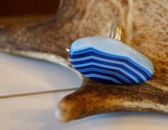 Blue striped stone cocktail ring.