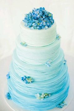 blue ombre wedding cake with blue flowers | more wedding day inspiration @danellesbridal danellesboutique.com