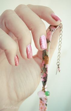Beautiful pink manicure with pink glitter accent nails
