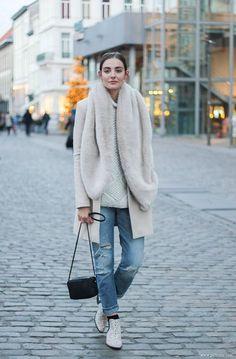 Dress up your boyfriend jeans with a bit of faux fur.