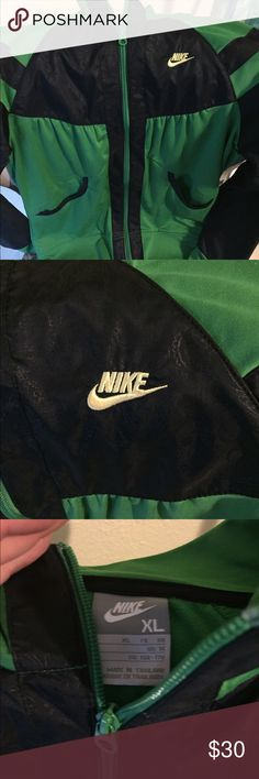 NWOT'S Nike jacket Perfect condition, blue was a paisley print in it, very nice! Nike Jackets & Coats