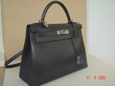 Kelly 32 sellier Box leather in Graphite color with palladium HDW