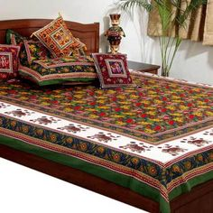 Jaipuri Pure Cotton 3 Piece Double Bed sheet set contains: A. One Double Bed Sheet in traditional Sanganeri print of Jaipur. This admiring bed sheet is embellished with multi-colour floral motifs on green base. It is graced with latest Sanganeri design on border to give an ethnic yet modern glance. The product presents a good example of traditional craftsmanship of Rajasthan