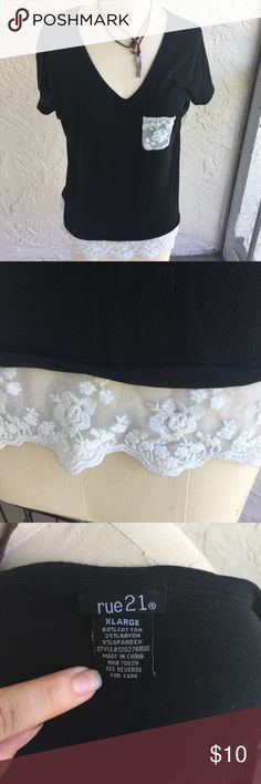 Rue 21 black lace top Worn gently, no rips or stains. White lace detail at bottom of shirt. Lace pocket accent. Size XL but I would say it could fit a Large comfortably. Rue 21 Tops Blouses