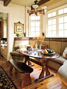 In this sunny breakfast room, the leather upholstered banquette resembles a church pew. A quatrefoil design is carved into the base of the table to reflect Gothic-style this would work great in my kitchrn wnith the back not so higharchitecture found in so many Episcopal churches. (Photo: Laurey W. Glenn)