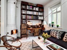 I like idea of connection living room with the work zone. Wonderful combination of wood with white.