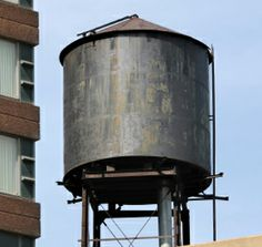 A rusty old water storage tank.