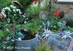 JJ De Sousa's bold garden digs: Portland Garden Bloggers Fling   Digging. stock tank water garden, glass orbs, landscaping, landscape design, water element, water feature