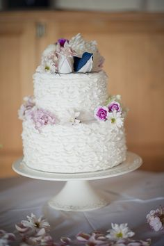 White wedding cake embellished with pink flowers