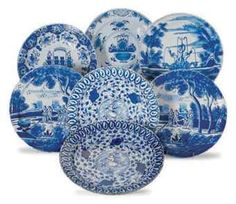Seven large Dutch Delft blue and white dishes, 18th century.