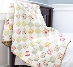 pretty - I need to remember this website when it's time to have a baby. I love quilts!