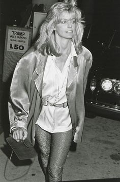 Farrah Fawcett, 1985 | The Charlie's Angels star opted for high-shine leggings for a night out on the town, styling the sparkle with a belted tunic and a satin oversize blazer.