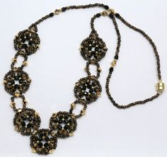 Deb Roberti's Crocus Garden Necklace done in Bronze and Black