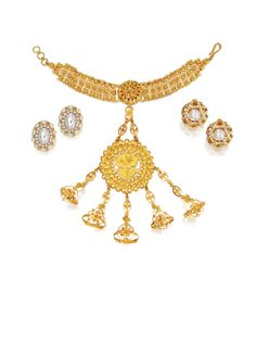 GROUP OF JEWELRY  $ 4,063   including a high karat gold Indian haath phool (a five-fingered hand ornament typically worn by brides) inscribed on the reverse Mrs. Brook Astor from Dr. Omar Zawawi, with box. Further comprised of two pairs of simulated pearl earclips.