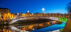 Ha'penny Bridge Dublin at dusk over the river Liffey, Dublin, Ireland. Best Holiday Deals, Ashford Castle, Coach Tours, European Holidays, Over The River, Travel Tours, Travel Destinations, Sydney Harbour Bridge, Ireland