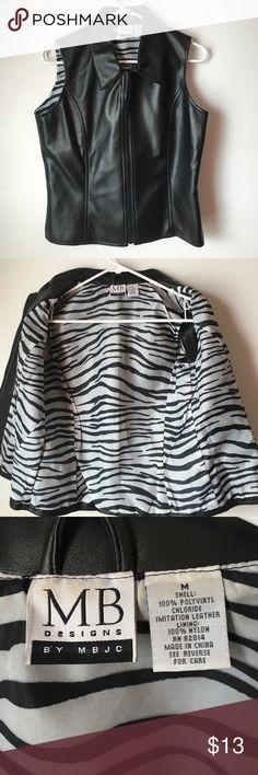 Black polyvinyl zebra print vest medium Black polyvinyl size medium zebra print lining vest ! It's in excellent condition MB Designs Jackets & Coats Vests