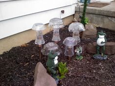 glass mushrooms over solar lights with frogs