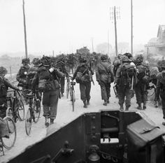 BRITISH ARMY NORMANDY 1944 (B 5078)   Troops from 3rd Division, some with bicycles, move inland from Sword Beach, 6 June 1944. Photograph taken from a Universal carrier.