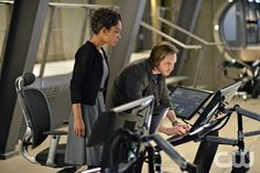 Nikita -- Invisible Hand -Pictured (L-R): Lyndie Greenwood as Sonya and Aaron Stanford as Birkoff -- Credit: Sven Frenzel/The CW --  2013 The CW Network. All Rights Reserved
