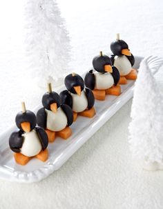 pinguïn (Maybe, with aged cheese, black olives and mozzarella or another savory spread?)