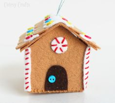 Felt Gingerbread House Ornament Tutorial - peppermint candy detail above the door.