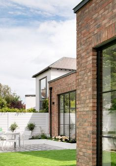 This project involved the complete refurbishment and extension of a semi-detached property in Sandymount. The clients have three young children and wanted a home that was fun as well. Brick Cladding, Brick Facade, Facade House, Brick Extension, House Extension Design, Red Brick Exteriors, Red Brick Homes, Modern Brick House, Brick Houses