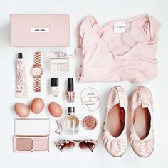 Flat lay fashion in pastel pink by Shine by Three. Miu miu clutch, ballet flats, sweater, sunglasses, rose gold watch